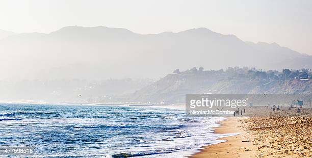 Santa Monica beach on misty evening mountains in background