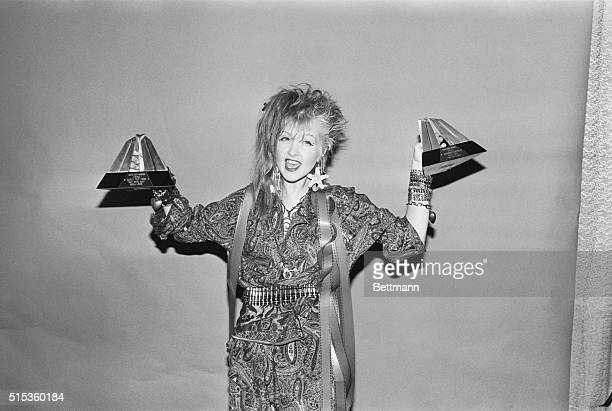 Cyndi Lauper and Ed Griles hold their awards Lauper was named best female performer and Griles was honored for directing her video Time After Time