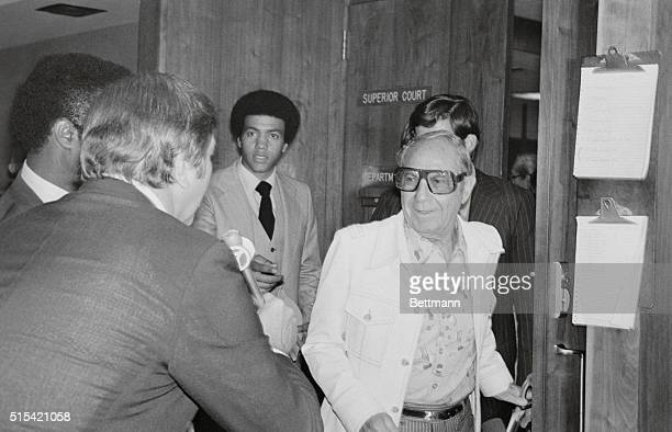 """Santa Monica, Calif.: Groucho Marx' younger brother Zeppo talks to reporters as he leaves courtroom at Santa Monica Superior Court. Zeppo said, """"it..."""