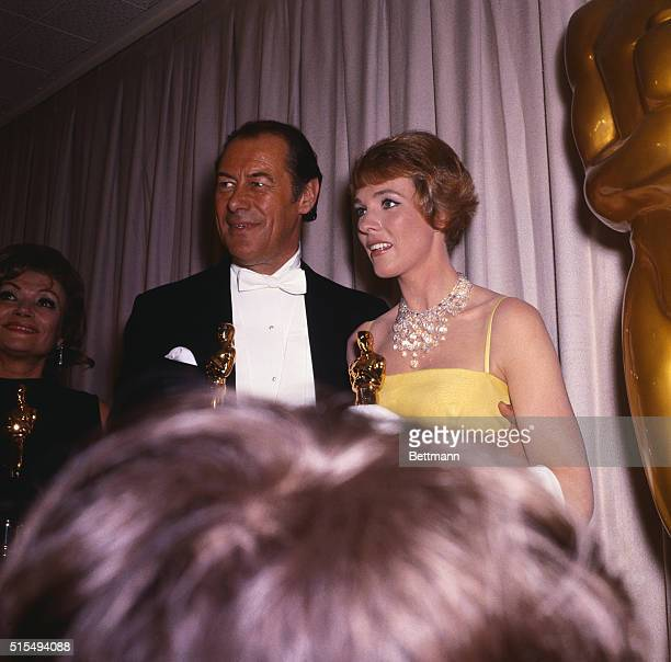Santa Monica CaliforniaActor Rex Harrison winner of an Oscar for his performance in My Fair Lady stands with Julie Andrews who won her Oscar for best...