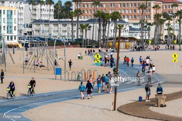 Santa Monica, Los Angeles, California, USA: people having a walk on the beach.