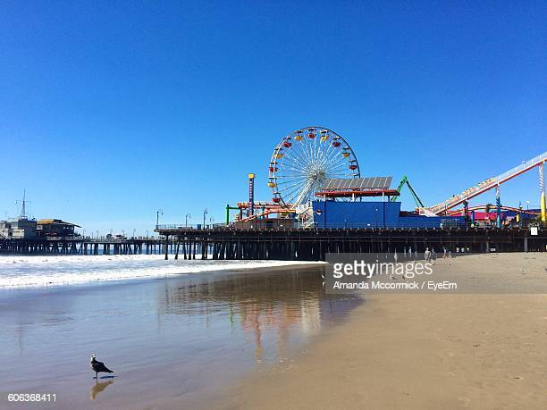 Santa Monica Pier At Beach Against Clear Blue Sky