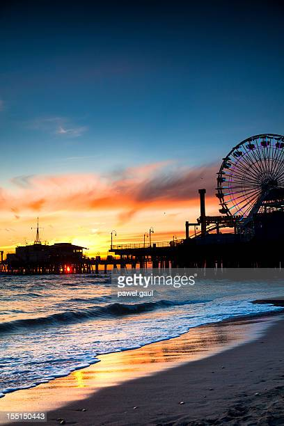santa monica pier at sunset. - santa monica stock pictures, royalty-free photos & images