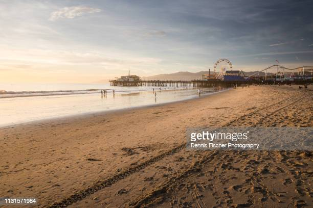 santa monica pier sunset - la beach stock pictures, royalty-free photos & images