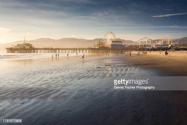 santa monica pier sunset - southern california stock pictures, royalty-free photos & images