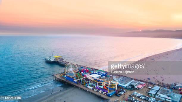 santa monica pier sunset - santa monica pier stock pictures, royalty-free photos & images