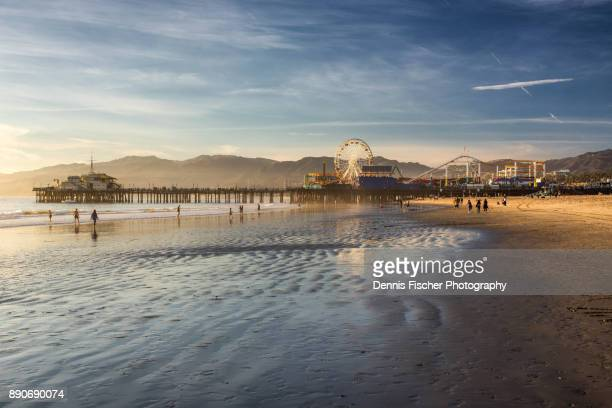 santa monica pier sunset - california stock-fotos und bilder