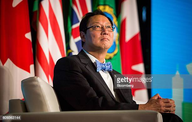 Santa Ono, president of the University of British Columbia, listens in a panel discussion during the Emerging Cascadia Innovation Corridor Conference...