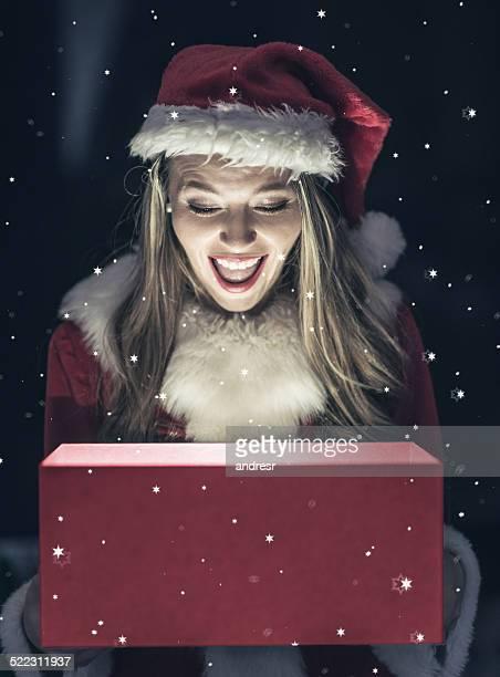 Santa opening a Christmas present