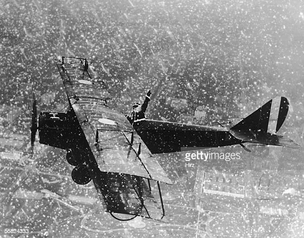 Santa pilots a biplane through a snowstorm a more modern approach to delivery than the classic sleigh and reindeer alternative circa 1920s