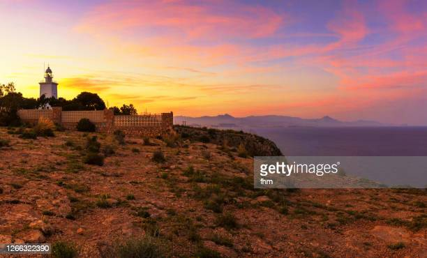 santa pola lighthouse at sunset (spain) - alicante stock pictures, royalty-free photos & images
