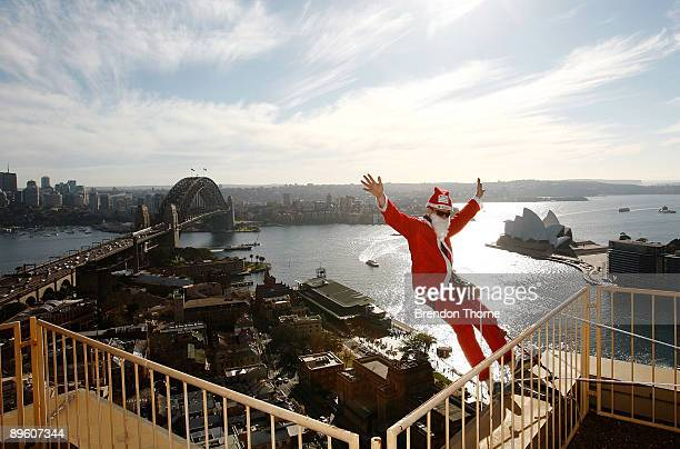 Santa poses prior to abseiling down the front of Sydney's Four Season's Hotel to launch the Sydney Santa Fun Run on August 5 2009 in Sydney Australia...