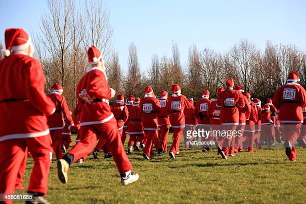 santa race - father christmas stock photos and pictures