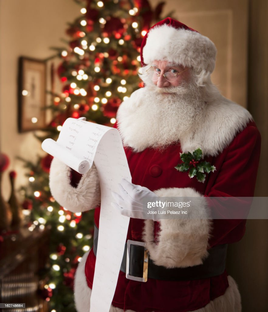 Santa reading list : Stock Photo