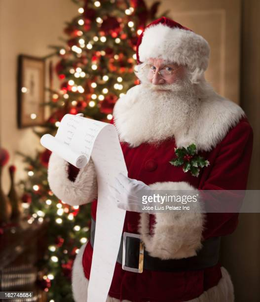 santa reading list - naughty santa stock photos and pictures