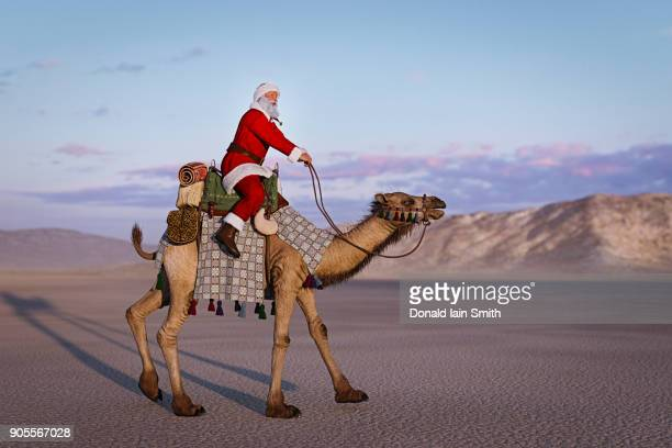 Santa riding camel in desert