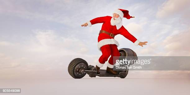 santa riding futuristic skateboard - pere noel humour photos et images de collection