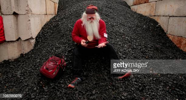 TOPSHOT Santa School student Jerry Julian of Colorado Springs Colorado sits in the coal pile Pere Marquette 1225 steam train contemplating which bad...