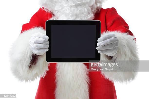 Santa mostrando um tablet digital na câmara