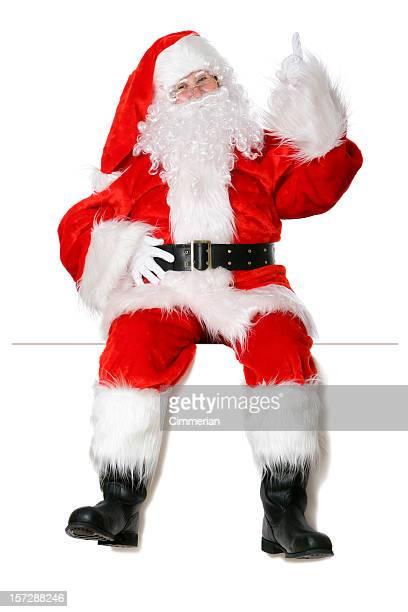 Santa sentada em uma borda branca