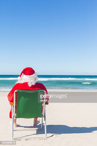 Santa Sitting on the Beach