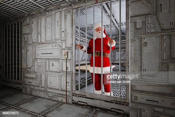 Santa standing in futuristic jail cell