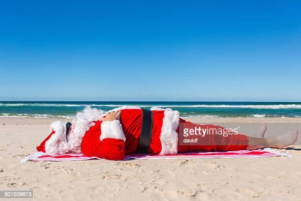 Santa Sunbaking on the Beach