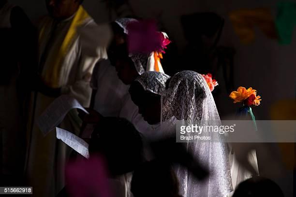 Santa Teresa D´Avila celebration at Itamatatiua Quilombo Alcantara Maranhao State northeastern Brazil Black young women pray and sing inside catholic...
