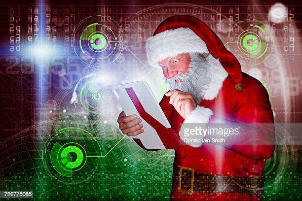 Santa using futuristic digital tablet
