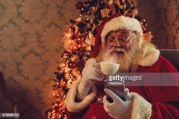 santa using mobile - santa stock pictures, royalty-free photos & images
