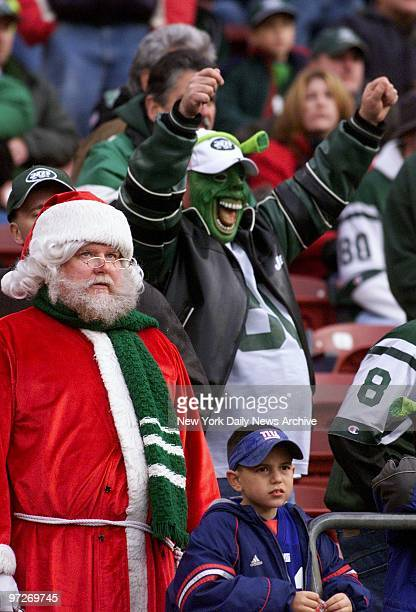 Santa waits to see whether the New York Jets will be naughty or nice while a big green Jets fan cheers and a little Giants fan sneers The Jets beat...