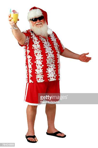 santa with a tropical drink - hawaiian shirt stock photos and pictures