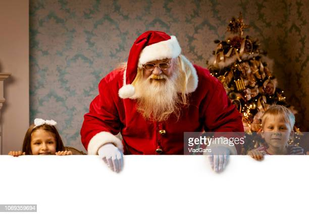 Santa with blank empty white poster