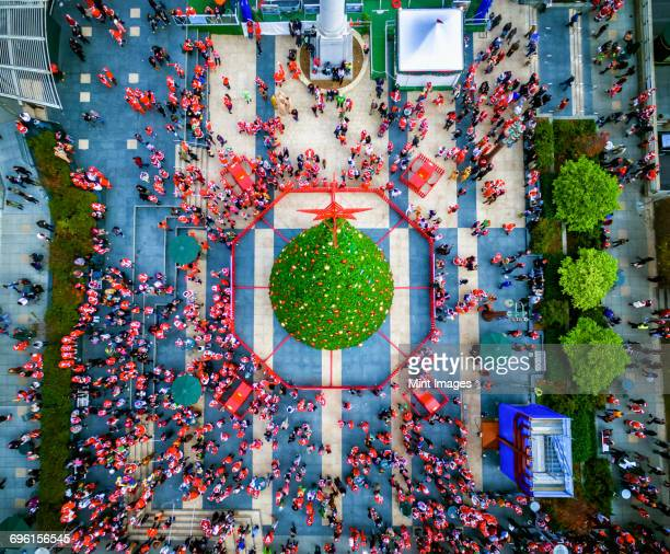 santacon parade in 2015. aerial view over union square in san francisco. - parade stock pictures, royalty-free photos & images