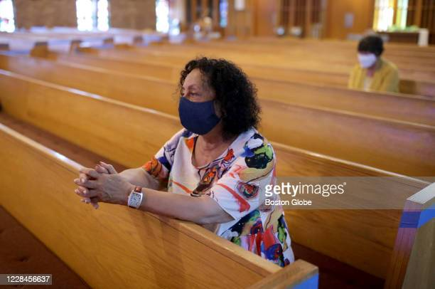 Santajean De Santis sits during a peaceful vigil at the Community of St. Anselm Church in Sudbury, MA on Sept. 10, 2020. Members of the church are...