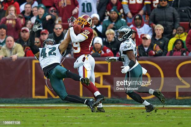 Santana Moss of the Washington Redskins catches a pass for a touchdown in between Kurt Coleman and Brandon Boykin of the Philadelphia Eagles at FedEx...
