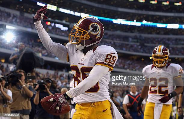 Santana Moss of the Washington Redskins celebrates a touchdown against the Dallas Cowboys during a Thanksgiving Day game at Cowboys Stadium on...