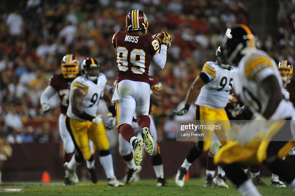 Santana Moss #89 of the Washington Redskins makes a catch against the Pittsburgh Steelers at FedExField on August 12, 2011 in Landover, Maryland. The Redskins defeated the Steelers 16-7.