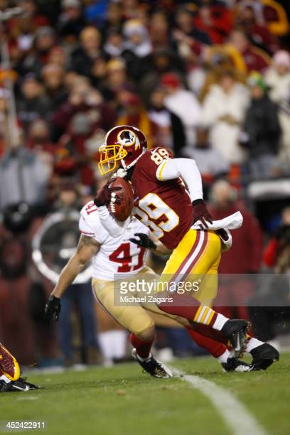 Santana Moss of the Washington Redskins returns a punt during the game against the San Francisco 49ers at FedEx Field on November 25 2013 in Landover...