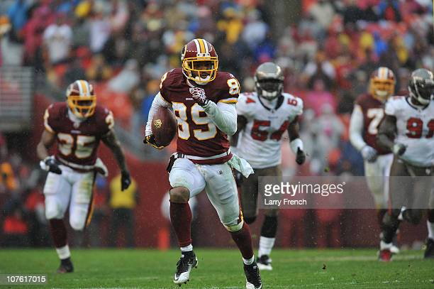 Santana Moss of the Washington Redskins runs the ball after a catch during the game against the Tampa Bay Buccaneers at FedExField on December 12...