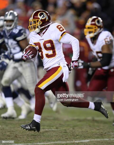 Santana Moss of the Washington Redskins runs with a catch against the Dallas Cowboys at Fedex Field on December 27 2009 in Landover Maryland