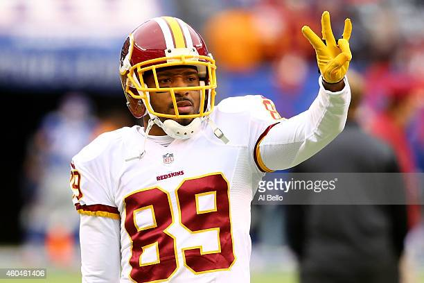 Santana Moss of the Washington Redskins signals during warmups prior to their game against the New York Giants at MetLife Stadium on December 14 2014...