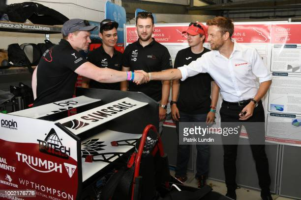 Santander Ambassador Jenson Button meets a team during the 20th Anniversary of the Formula Student competition at Silverstone Circuit on July 14 2018...
