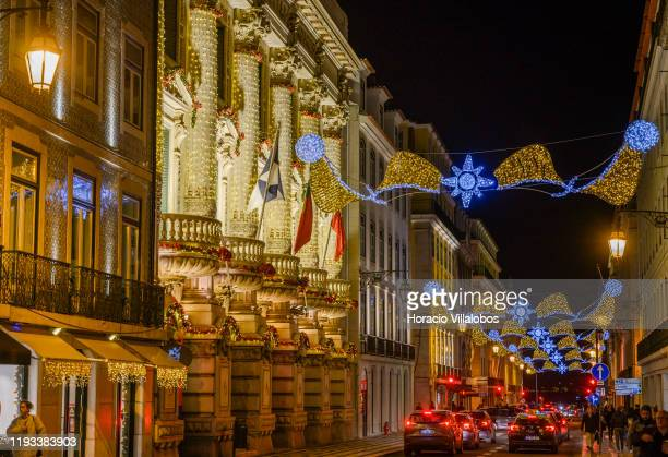Santander Bank building lit for the occasion and street Christmas and New Year illuminations in Rua Aurea, Chiado, on December 11, 2019 in Lisbon,...