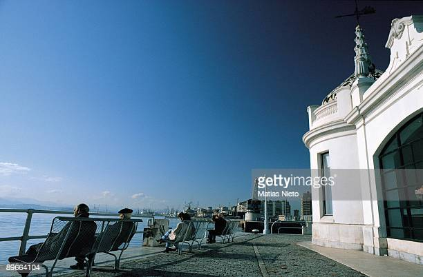 Santander Cantabria Seated people in the banks of the port contemplate the sea next to the ´house of passengers´
