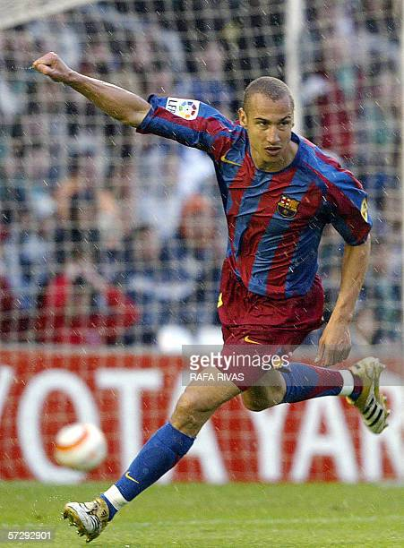 Barcelona's Swedish striker Henrik Larsson celebrates a goal 09 April 2006 during a Spanish league football match against Racing Santander at the...