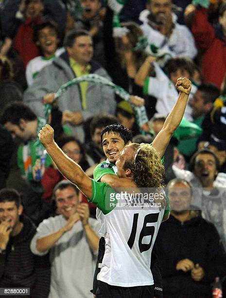 Santander's Jonathan Pereira is congratulated by his teammate Jorge Gonçalves after scoring during the UEFA Cup first round football match Racing...