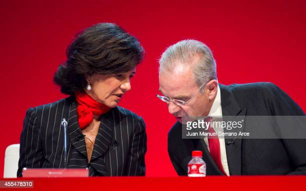Santander's new chairwoman Ana Patricia Botin speaks with Banco Santander's General Secretary Ignacio Benjumea during an Extraordinary General...