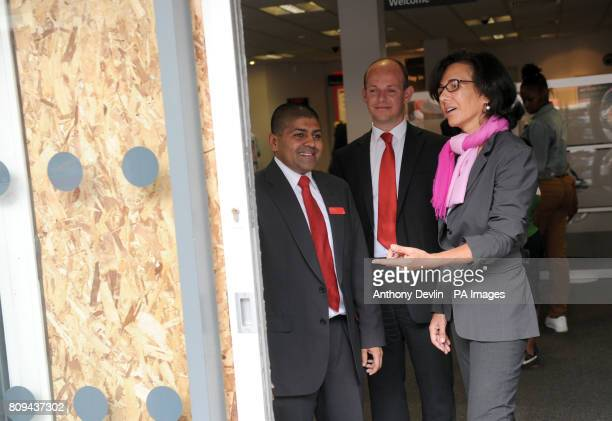Santander's UK Chief Executive Ana Patricia Botin inspects the damage with branch manager Nik patel and performance director Bruce Rioch during a...
