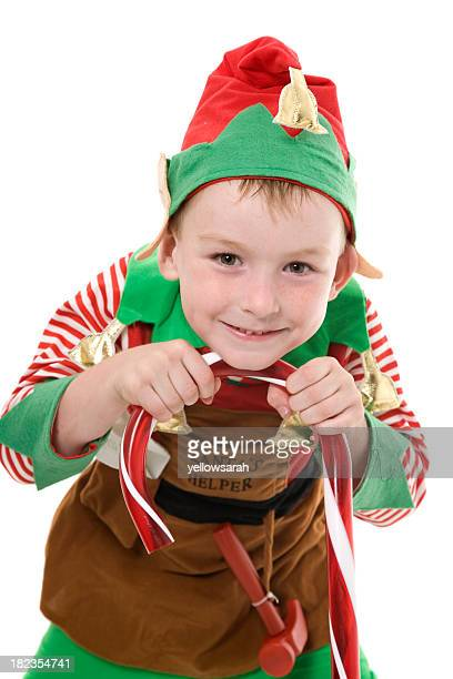 santa's helper smiling - naughty santa stock photos and pictures